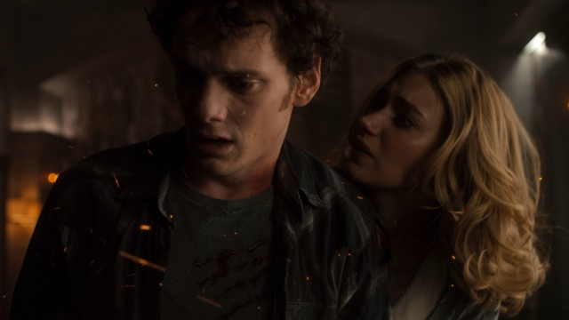 Embers of fire fly as Charley (Anton Yelchin) and Amy (Imogen Poots) try to slay a vampire.