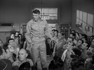 Though he repeatedly claims he doesn't want to become a commanding officer, Sgt. Milton Warden (Burt Lancaster) assumes an authority position during the climactic attack on Pearl Harbor.