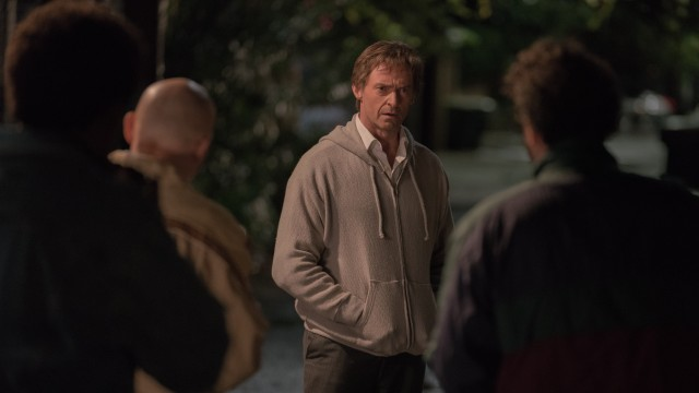 In an alleyway, Gary Hart (Hugh Jackman) confronts the journalists and photographer who have been staking out his home.