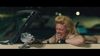 Johnny Knoxville, dressed like Dog the Bounty Hunter, cracks up in the gag reel.