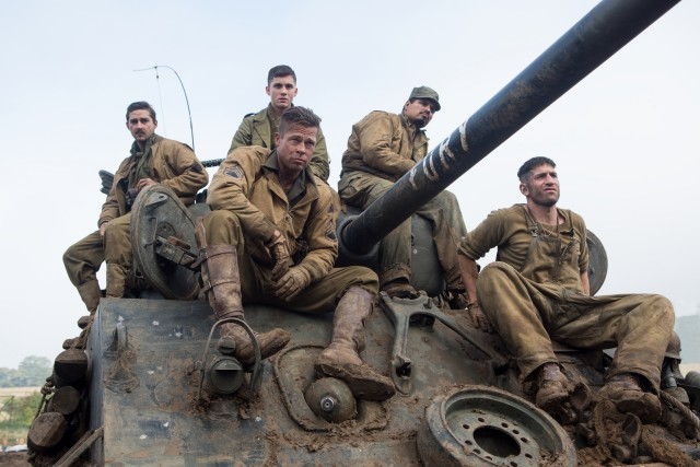 The five men who operate the U.S. Army tank Fury (left to right, Shia LaBeouf, Logan Lerman, Brad Pitt, Michael Pena, and Jon Bernthal) sit atop it.
