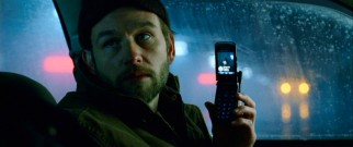 The psycho prostitute killer Carl (Dallas Roberts) shows off a state-of-the-art camera phone, circa early 2008.
