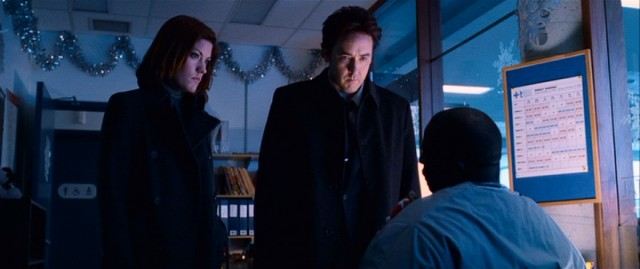 In a hospital decorated for the holidays, Kelsey (Jennifer Carpenter) and Mike (John Cusack) question an associate and accomplice of the Buffalo serial killer.