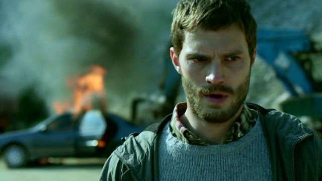 Hunted serial killer Paul Spector (Jamie Dornan), seen here coolly walking away from an exploded car, is the series' other focus.