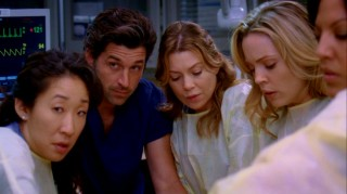 "The doctors of Seattle Grace Hospital (Sandra Oh, Patrick Dempsey, Ellen Pompeo) momentarily forget their busy personal lives to perform a very serious operation in the fifth season of ""Grey's Anatomy."""