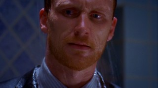 Owen (Kevin McKidd) makes a face that only a bearded man showering in a suit can.