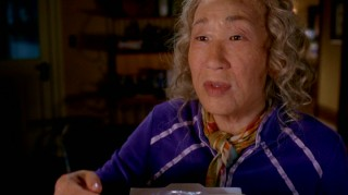 After being impaled by an icicle, Cristina (Sandra Oh) imagines life as an old woman.