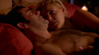 Denny (Jeffrey Dean Morgan) and Izzie (Katherine Heigl) cuddle topless after some ghost sex.