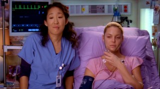 Two doctors, one healthy (Sandra Oh), one sickly (Katherine Heigl) look and comment upon Meredith's potential wedding dresses