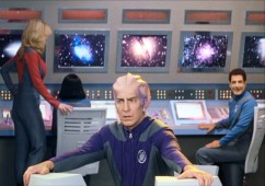 "The windowboxed opening minute of the film gives us a look at a ""Galaxy Quest"" episode. Featured here are Tawny, Dr. Lazarus (Alexander Dane, a.k.a. Alan Rickman) and Tech Sergeant Chen (Fred Kwan, a.k.a. Shalhoub!)."
