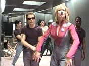 "Sigourney Weaver raps, as do Sam Rockwell and Daryl ""Chill"" Mitchell, while Missi Pyle and Patrick Breen dance in the background."