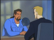 Nearly out of prison, Xanatos confers with his assistant Owen.