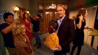 "Jay Mohr holds up a papier-mâché likeness of Maya Angelou, while Kathryn Newton and guest Cerina Vincent get hair touch-ups and Paula Marshall looks at her script in behind-the-scenes video from featurette ""The Chemistry of Comedy."""