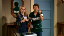 Louise (Kathryn Newton) and Tommy (Ryan Malgarini) get their parents' attention by holding Michael Bolton and Bruce Springsteen tickets above a paper shredder.