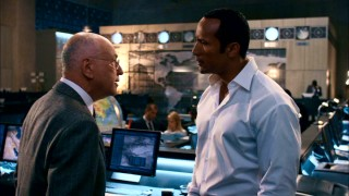 "The Chief (Alan Arkin) has a talk with Agent 23 (Dwayne Johnson, hold ""The Rock"") about stapling."