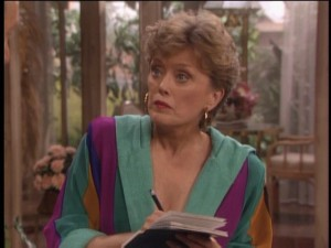 Blanche gets unexpected news. (Perhaps that her top has been designed to help you calibrate your color settings.)