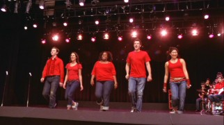 "Kurt, Rachel, Mercedes, Finn, and Tina perform Journey's ""Don't Stop Believing"" for no one but themselves as Artie and the band jam out in the background."