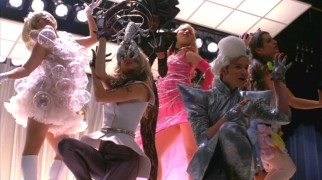 "The New Direction girls (and Kurt) perform ""Bad Romance"" for their Lady Gaga theme, something the other guys aren't too keen on experiencing for themselves."