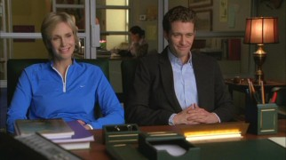 Sue (Jane Lynch) and Will (Matthew Morrison) are all smiles while in Principal Figgins' office, but the bloodbath will soon commence afterwards.
