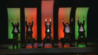 Will's new a capella group, the Acafellas show off what they could do at the school's faculty meeting of all places.