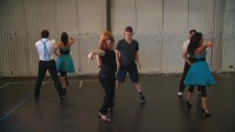 "In ""Staying in Step with Glee,"" choreographers Zach Woodlee and Brooke Lipton break down Vocal Adrenaline's ""Bohemian Rhapsody"" dance."