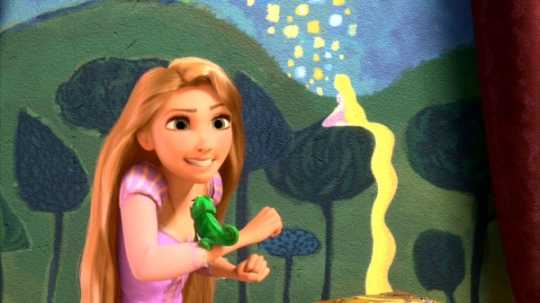 "Rapunzel and her chameleon pal Pascal embrace adventure in Disney's ""Tangled."""