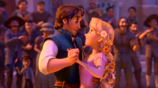 Flynn Rider and Rapunzel share a dance in the town square.