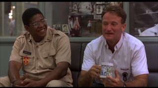 Edward Garlick (Forest Whitaker) and Adrian Cronauer (Robin Williams) share a laugh.