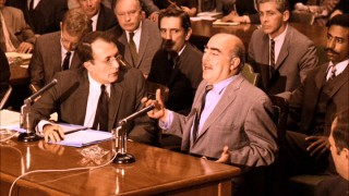 The FBI's star witness in Part II's Senate hearing, Frankie Pentangeli (Michael V. Gazzo) has stories to tell. Or does he? Harry Dean Stanton looks unsure.