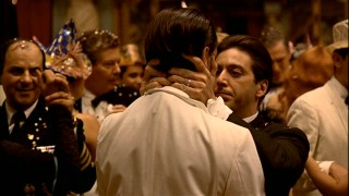 Celebrating the New Year in Cuba, Michael plants baccio di tutti bacci (the kiss of all kisses) on his brother Fredo (John Cazale) in this powerful scene. Still from The Godfather Part II's 2001 DVD - click to view screencap in full 720 x 480.