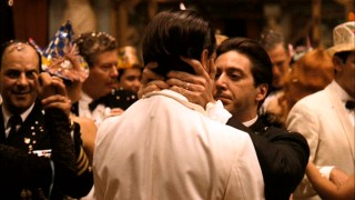 Celebrating the New Year in Cuba, Michael plants baccio di tutti bacci (the kiss of all kisses) on his brother Fredo (John Cazale) in this powerful scene. Still from The Godfather Part II's 2008 DVD - click to view screencap in full 720 x 480.