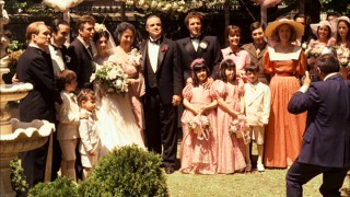The Corleone family takes a big happy group photo on the day of Connie's wedding.