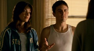Angie Gennaro (Michelle Monaghan) and Patrick Kenzie (Casey Affleck) aren't dressed in the most professional attire when their services are sought by a missing girl's family.