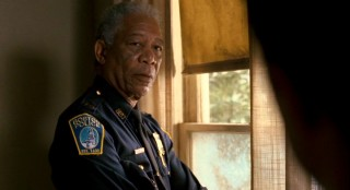 In between portraying God and Nelson Mandela, Morgan Freeman played this authority figure, Boston police captain Jack Doyle.