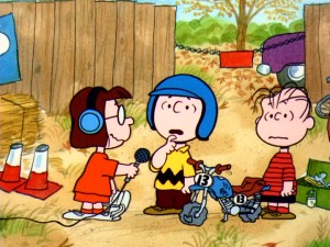 As announcer of the motocross race, Marcie doesn't let Charlie Brown or any of his competitors say very much.