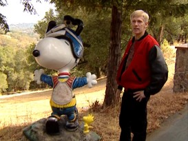 "Craig Schulz, son of Peanuts creator Charles Schulz, comments on the authentic 1970s attire of this Motocross Snoopy statue in the featurette ""Dust Yourself Off..., Charlie Brown."""