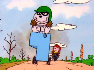 Snoopy is all smiles as he pulls ahead of pumpkin-helmeted Charlie Brown on his refashioned tennis ball machine vehicle.