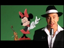 "A little bit of Minnie in his life: one-hit wonder Lou Bega performs ""Disney's Mambo No. 5"" in this included music video."