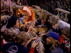 "Cyndi Lauper and the Goonies find treasure in her ambitious two-part music video for the film's theme tune ""The Goonies 'R' Good Enough."""