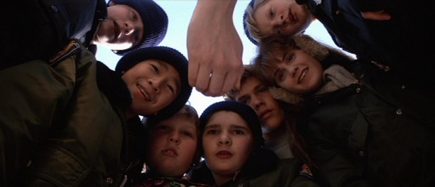 Outside again, the seven Goonies -- left to right, Mikey (Sean Astin), Data (Ke Huy Quan), Chunk (Jeff Cohen), Mouth (Corey Feldman), Brand (Josh Brolin), Andy (Kerri Green), and Stef (Martha Plimpton) -- are pleased by what this hand holds.
