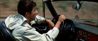 """And here's to you, Mrs. Robinson""... Ben shatters the speed limit in pursuing what he believes to be his dream girl."