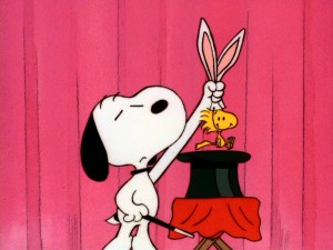 "The Great Houndini, a.k.a. Snoopy, pulls a bunny, i.e. Woodstock with bunny ears, out of his hat in ""It's Magic, Charlie Brown."""