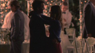 Rusty and Jordan (Johanna Braddy) finally get to spend a quiet moment alone together during the wedding reception of a former ZBZ member.