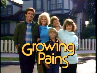 "Show me that smile again (show me that smile)... The Seavers pose jovially outside their Long Island home in the ""Growing Pains"" opening title sequence."