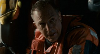"Kevin Costner gives his best pained look at as United States Coast Guard rescue swimmer Ben Randall, a.k.a. ""The Guardian."""
