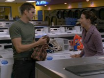 "Budding but casual lovers Jake (Ashton Kutcher) and Emily (Melissa Sagemiller) spend laundry time together in a deleted scene from ""The Guardian."""