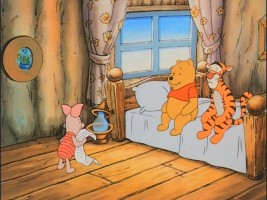 Piglet shares his own writing with an attentive Pooh and Tigger.