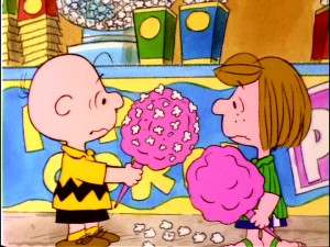 Peppermint Patty reconsiders adding popcorn to her cotton candy after looking at the unappealing results of the mixture she's made Charlie Brown.
