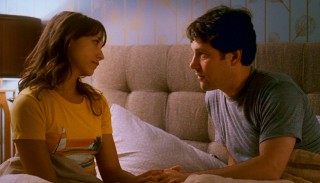 Zooey (Rashida Jones) listens as Peter (Paul Rudd) comes clean about his series of man dates.