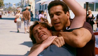 Playing himself Lou Ferrigno shows some of his Incredible Hulk muscle as he puts a disorderly Sydney (Jason Segel) into a sleeper hold.